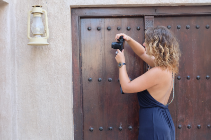 woman,  photographing,  lantern,  blue,  dress,  ashion,  technology,  camera,  blonde,  hair,  summer,  door,  wood,  light