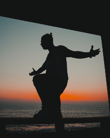 silhouette,  man,  beach,  arms,  outstretched,  sunset,  sunrise,  ocean,  sea,  water,  travel,  vacation,  holiday,  male,  person,  people