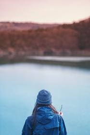 people, girl, woman, blue, beanie, coat, travel, outdoor, lake, water, nature, blur