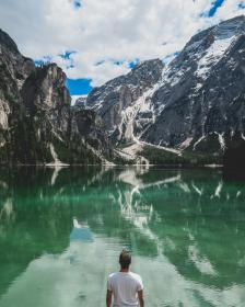 guy, man, male, people, back, contemplate, nature, mountains, rocks, snow, travel, trek, summit, peaks, fog, vegetation, grass, trees, rocks, sky, clouds, horizon, water, lake, sea, reflection, majestic, picturesque
