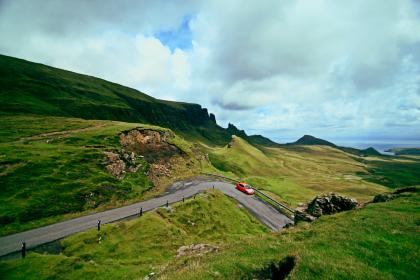 green, grass, highland, grassland, landscape, nature, mountain, car, vehicle, road, trip, travel, outdoor, sky, cloud