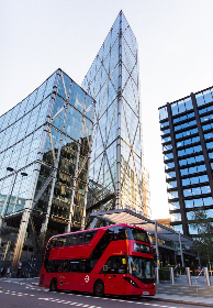 red,  bus,  skyscraper,  glass,  urban,  transportation,  city,  tall,  building,  buildings,  sky,  travel,  commuting,  touring,  transport