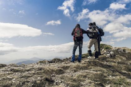 people, men, travel, adventure, mountain, mountaineer, clouds, sky, back pack, jacket, climbing, hiking