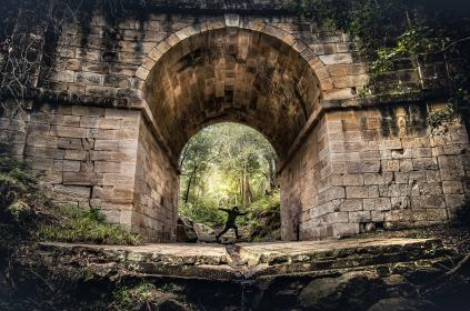 architecture, building, historic, site, arch, nature, outdoor, travel, trip, view, green, trees, plant, grass, moss, water, rock, people, guy, man, walking