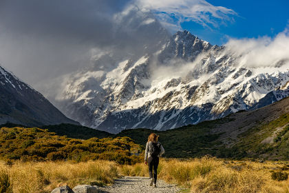 hiker,  mountains,  landscape,  snow,  scenic,  beautiful,  sky,  clouds,  grass,  rocks,  girl,  female,  backpacker,  backpacking,  trek,  path,  nature,  outdoors,  outside,  wanderlust,  travel,  roam,  explore,  adventure,  active,  exercise,  sport,  expedition,  hike,  hiking,  majestic,  tou