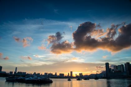 sea, ocean, dark, clouds, sky, sunset, skyline, buildings, city, urban, boat, yacht, water, transportation, travel