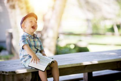 baby, kid, child, people, boy, laugh, happy, book, bible, sitting, table, outside, bokeh