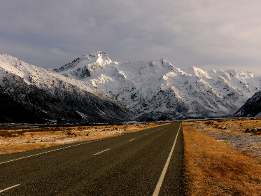 snowy,  mountains,  highway,  road,  landscape,  pass,  scenic,  peaks,  asphalt,  sky,  outdoors,  cloudy, nature, wanderlust