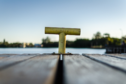 wooden deck,   lake,   anchor,   holiday,   vacation,   summer,   daylight,   dock,   sea,   landscape,   metal,   nature,   outdoors,   sky,   trees,   tube,   water