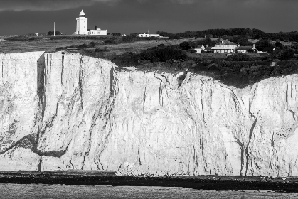rocky,  coastline,  cliff,  landscape,  ocean,  sea,  lighthouse,  mountain,  island,  land,  landmark,  nature,  monochromatic,  black and white,  horizon,  coast,  shore