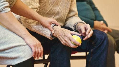 ball, people, old, elderly, man, sitting, woman, holding hand, arm