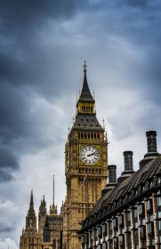 building, castle, palace, king, queen, pole, flag, nation, infrastructure, post, light, sky, clouds, clock, time, display