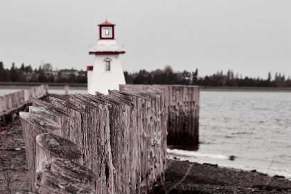 lighthouse,   coast,   architecture,   ocean,   island,   landmark,   light,   building,   scenic,   historic,   water,   horizon,   sea,  fence,  seawall