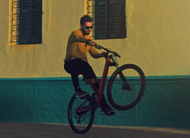people, man, men, bicycle, tire, shoes, wall, window, steel, concrete, sidewalk, night, exhibition, sports, game, play, ride, adventure, cyclist
