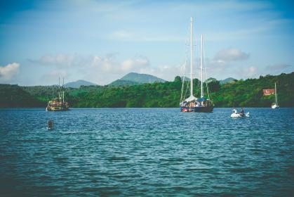 sea, ocean, water, waves, nature, horizon, green, trees, mountain, landscape, view, boat, sailing, outdoor, transportation