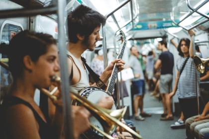 people, instrument, guitar, string, fret, trumpet, station, sound, music, train, transportation, vehicle