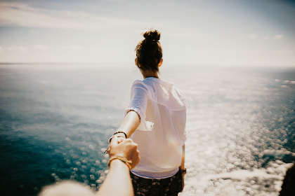 woman, adventure, beach, ocean, travel, explore, water, sea, shore, sky, outdoors, nature, holding, hands, walking, sunny, clouds, waves, female, person, summer