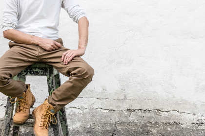 man,  sitting,  wall,  concrete,  rustic,  texture,  background,  work boots,  boots,  pose,  alone,  adult,  copy space,  male,  person