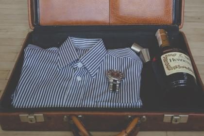 suitcase, shirt, clothes, fashion, watch, Hennessy, alcohol, bottle, leather, objects