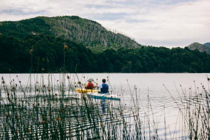 lake, river, water, grass, green, trees, mountain, forest, nature, sky, clouds, people, men, boat, sailing, paddle