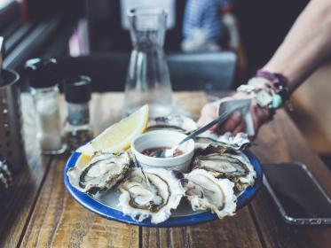 table, restaurant, bar, food, shell, seafood, raw, vinegar, sauce, lemon, hand, mobile, phone