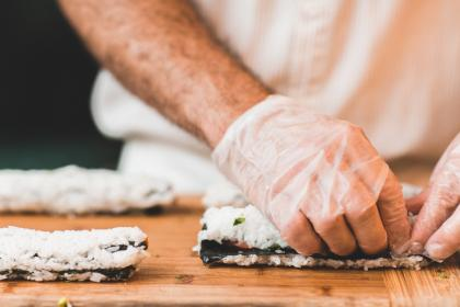 people, man, guy, chef, sushi, food, table, kitchen,hand, gloves