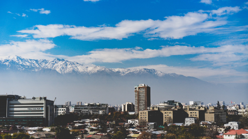 city,  buildings,  mountains,  cityscape,  sky,  clouds,  snow,  peaks,  horizon,  view,  scenic,  skyline,  business,  architecture,  homes,  houses,  valley