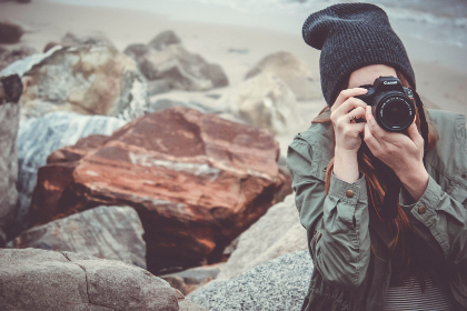 beach,  camera,  canon,  dslr,  girl,  outdoors,  person,  picture taking,  rocks,  stones,  taking photo,  water,  woman,  sand