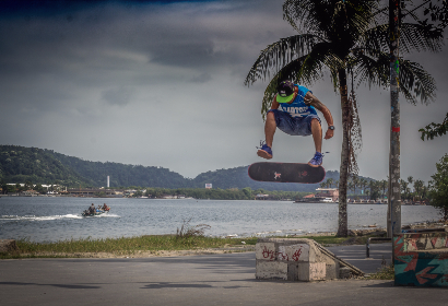 skateboarder,   jump,   flip,   tank top,   sunset,   action,   dawn,   dusk,   sport,   man,   outdoors,   fun,   recreation,   skateboard,   skateboarding