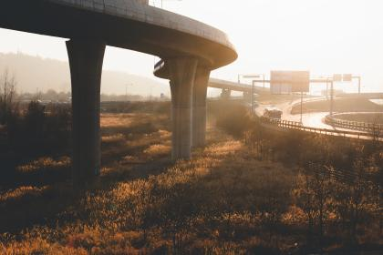travel, adventure, highway, road, car, vehicle, transportation, infrastructure, bridge, grass, plant, sunset