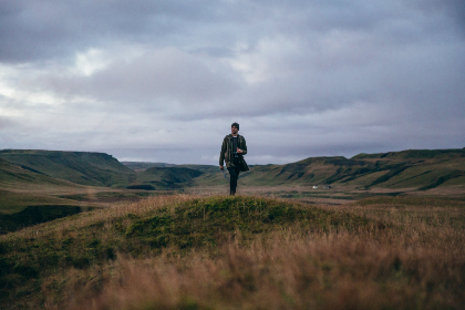 man,  hiking,  landscape,  cloudy,  sky,  field,  valley,  activity,  photographer,  camera,  overcast,  outdoors,  explorer,  walking,  moody