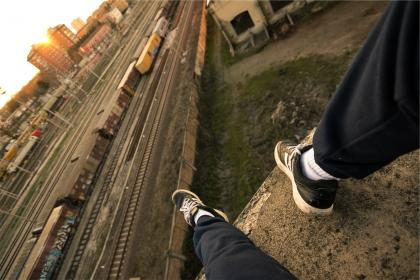 shoes, sneakers, sweat pants, railroad, railway, train tracks, transportation, cargo