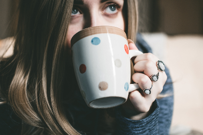 woman,  drinking,  coffee,  morning,  drink,  food,  tea,  cup,  mug,  hand,  rings,  people,  long hair,  blue eyes,   eyes,  spots