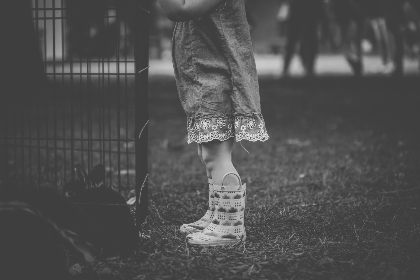 child,  boots,  monochrome,  garden,  kid,  girl,  people,  adventure,  fence,  metal,  dress,  skirt,  wellies,  grass,  trees