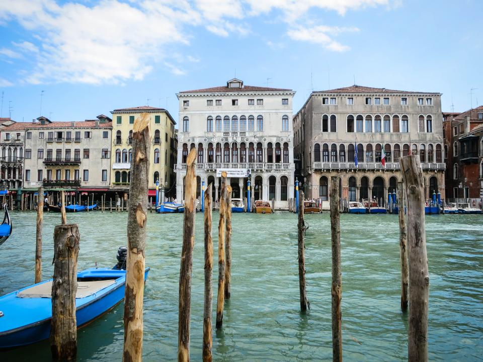 Venice Italy buildings houses architecture boats water docks wood city