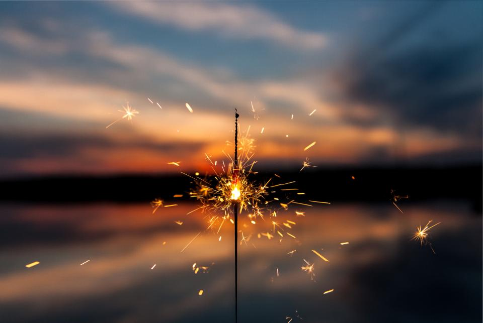 sparkler lights fire dark night blur clouds sky sunset