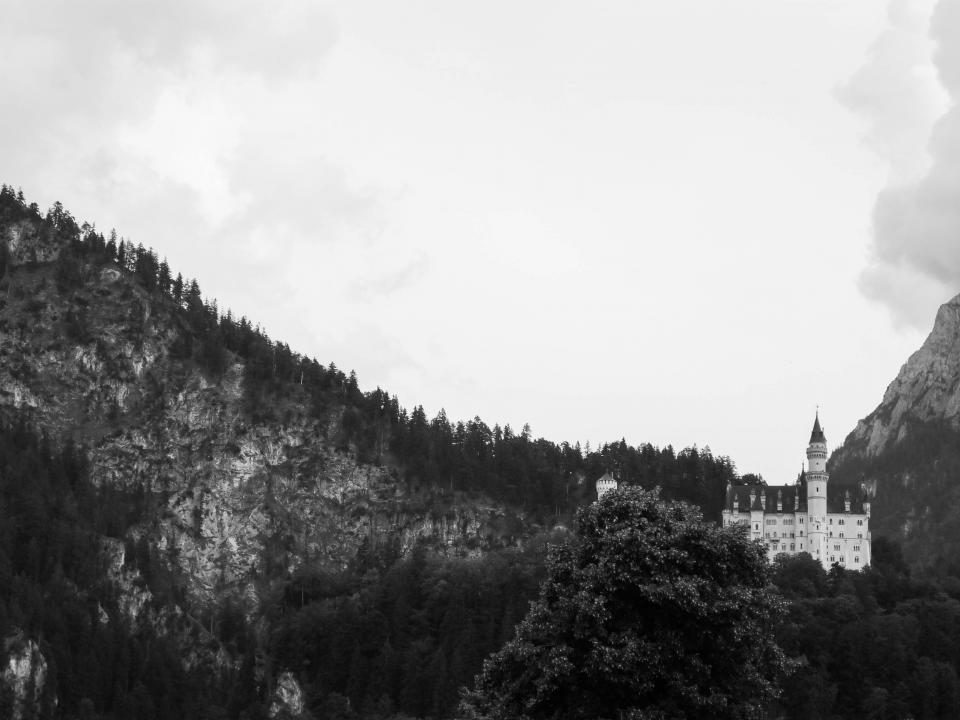 Neuschwanstein Castle Bavaria Germany architecture landscape mountains hills black and white