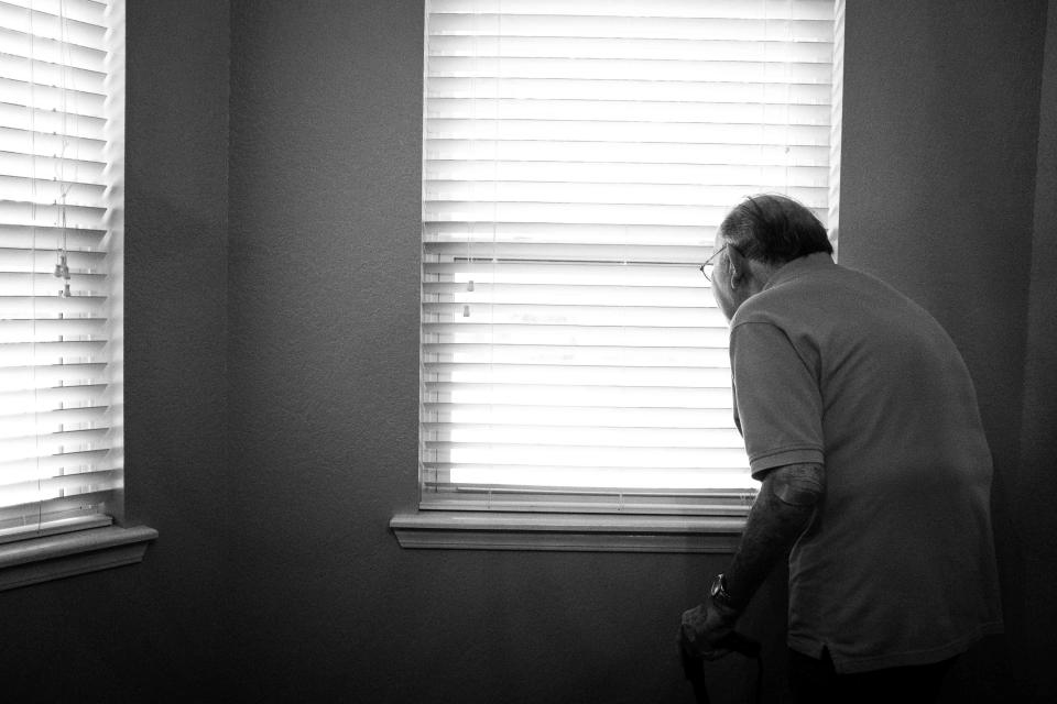 house interior window black and white old people man