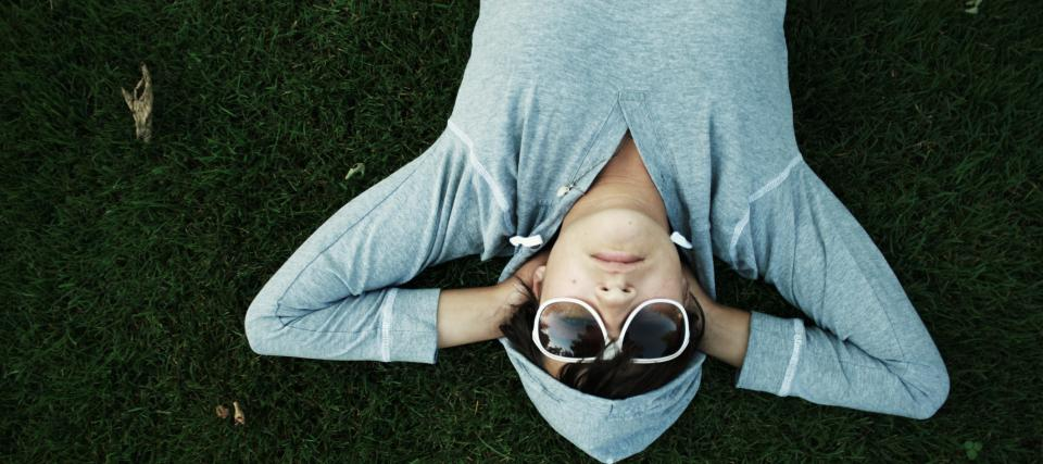 lying down hoodie sunglasses grass ground people