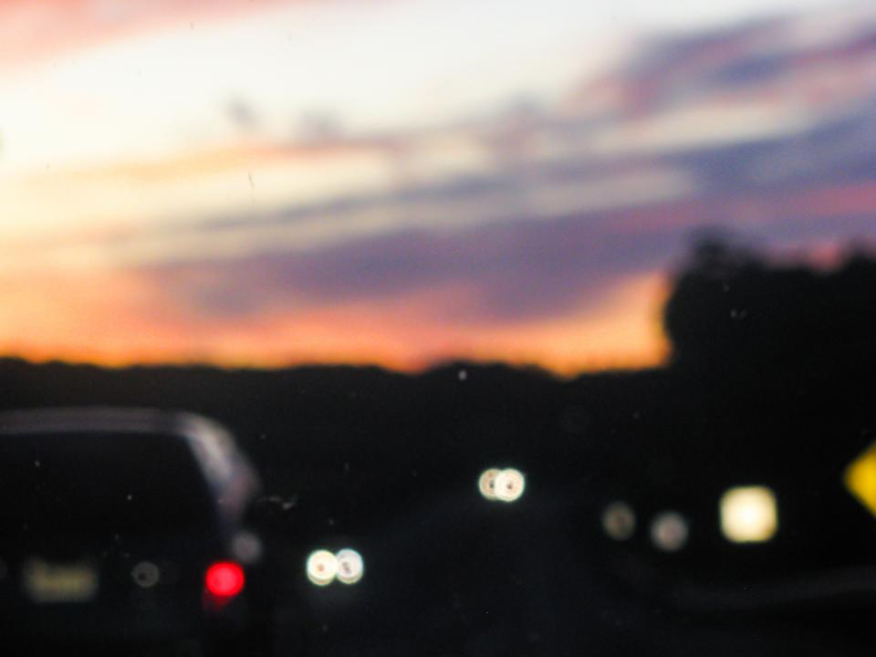 highway cars driving road sunset dusk evening night blurry