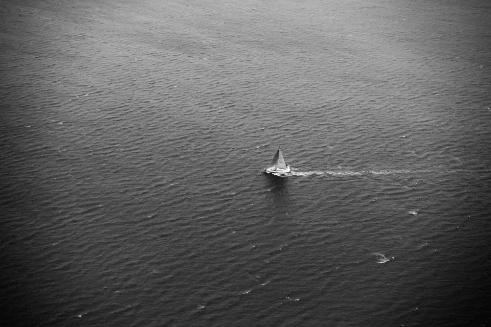 sailboat sea ocean waves water black and white