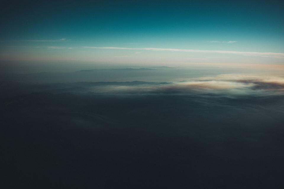 aerial view travel trip sky clouds sunset dusk mountains