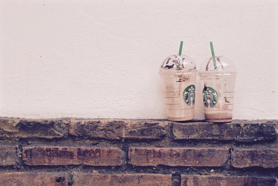 Starbucks coffee drinks bricks wall