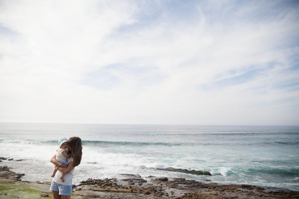 people woman family mother beach ocean sea love kiss cute baby kid waves clouds sky