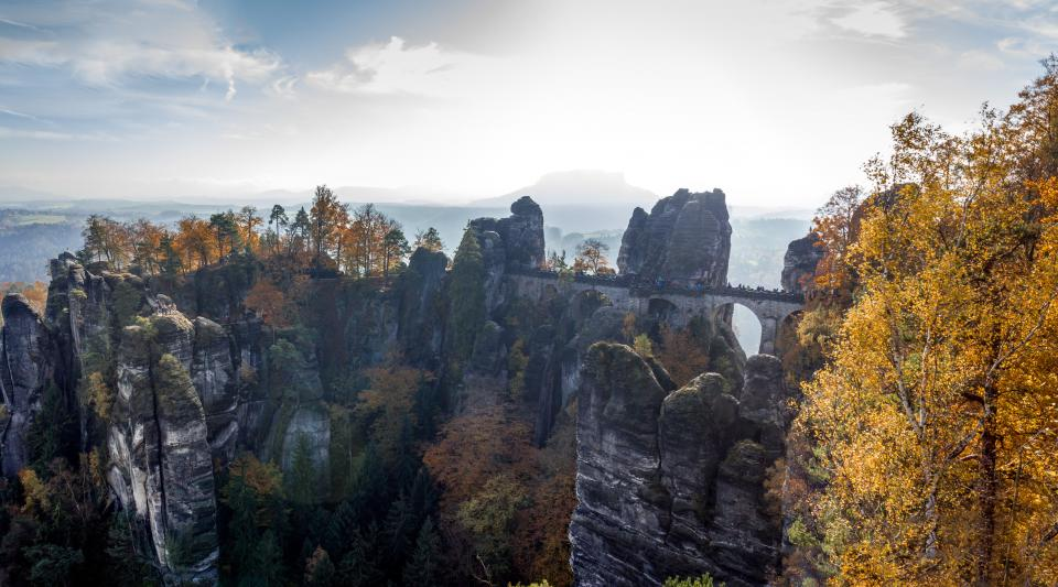 hill view rocks trees plant nature autumn fall cloud sky bridge structure outdoor