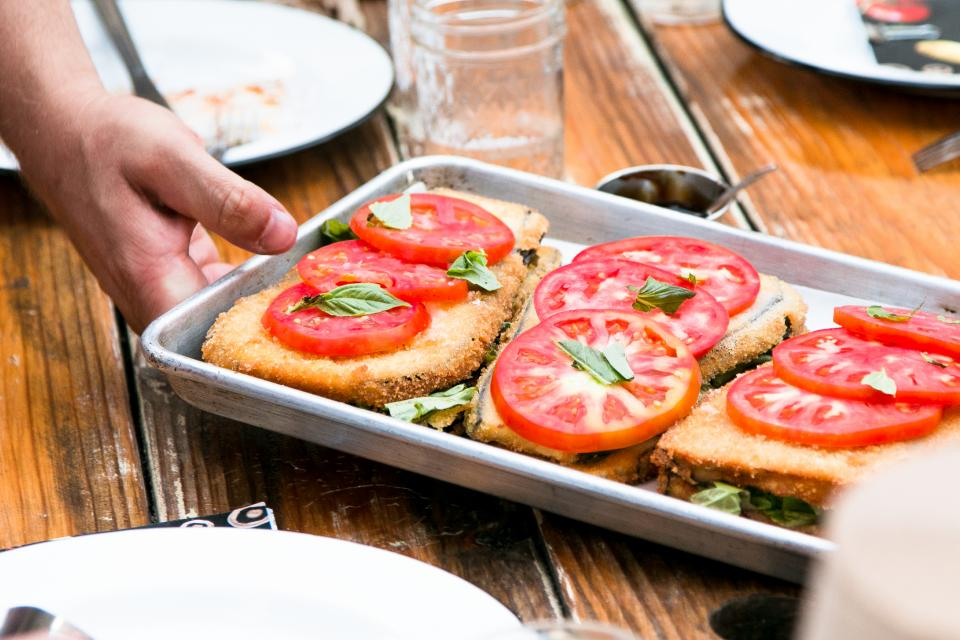 bread serve food restaurant table tray wood tomato fresh