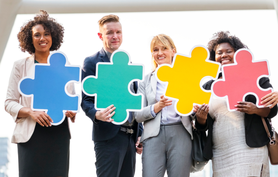 business people puzzle business district businessman businesswoman male female group colleagues workers city colorful connected corporate diverse downtown