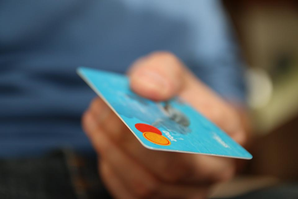 credit card money finance payment hand bokeh shopping