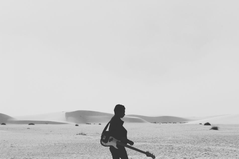 black and white sky desert sand hills dunes woman silhouette shadow electric guitar music instrument