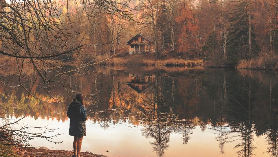 people woman alone reflection cabin house home trees forest woods river lake nature landscape